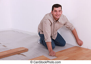 man laying parquet