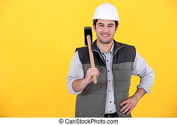Smiling laborer on yellow background