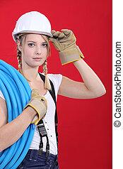 Young tradeswoman giving a salute