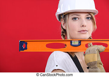 portrait of lovely blonde craftswoman holding ruler against...