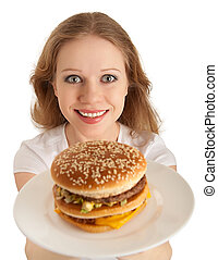 attractive young woman holds out a plate of fast food, hamburger isolated on white background
