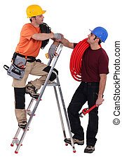 two electrician stood with step-ladder