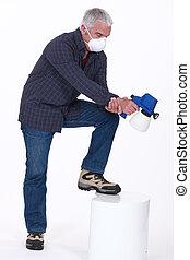 Man using a spray gun