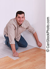 35 years old handyman laying parquet