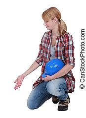 Female builder gesturing