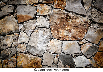 Medieval stone wall background or texture