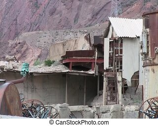 House in ruins in Tajikistan - A house in the middle of...