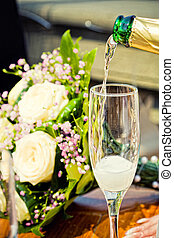 glass of champagne with bouquet