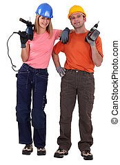 Couple stood with power drills