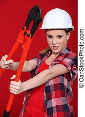Woman holding bolt cutters