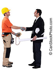 Architect and electrician shaking hands