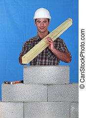 A mason/carpenter.