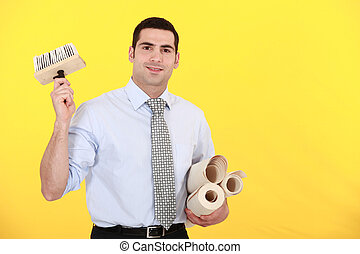 Man in shirt and tie holding wallpaper