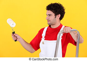 Man with step-ladder using paint-roller