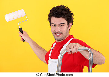 A painter holding a paint roller