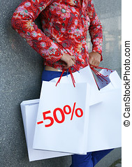 50 percent off - Young woman and the shopping bags...