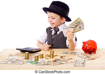 Boy at the table counts money - Little boy in black hat and...