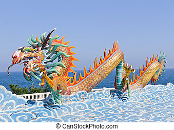 dragon statue against blue sky in chinese temple