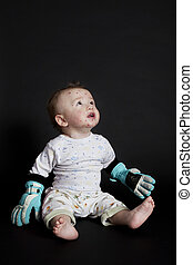 baby with chickenpox - little boy with chickenpox looking...
