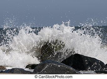 Crashing Waves - Waves crashing on the rock along the...