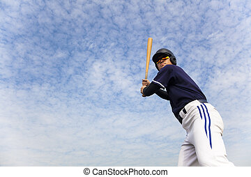 young baseball player ready for  swing