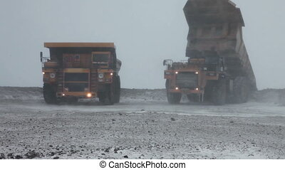 Heavy mining dump trucks