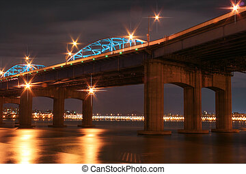 The Han River View from Seoul subwav at dusk, with starlike...