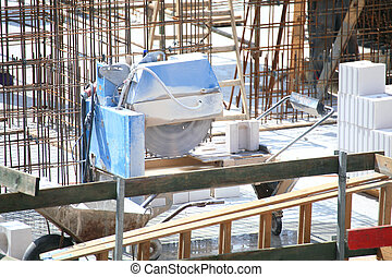 construction work of stone cutting by cut-off saw with...