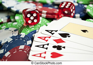 Four aces of a kind on casino chips wit two red dices