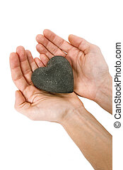 Hand holding massage stone isolated on white
