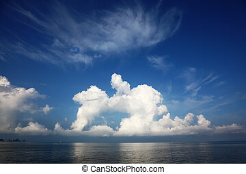 Clouds of the freakish form - The sea in tropics. Clouds of...