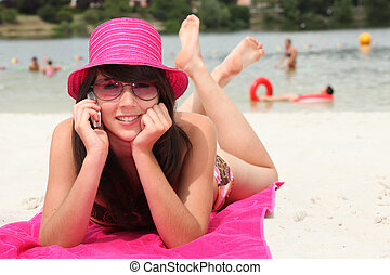 smiling 20 years old Asian girl relaxing on the beach and...