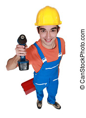 Young carpenter stood with cordless drill