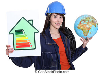 Woman holding an energy-saving drawing and a globe and wires