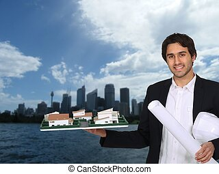 Architect holding model with urban landscape in background