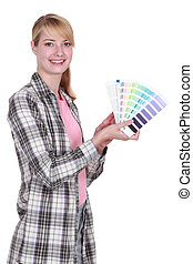 female painter holding color charts