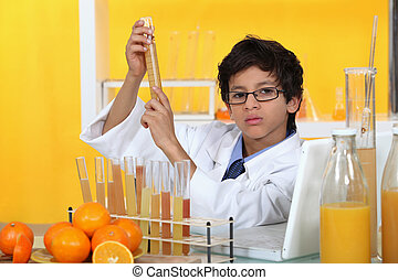 Child playing with a chemistry set and oranges