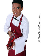 Waiter with bottle of rose wine