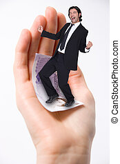 Successful businessman standing in a hand with stamp