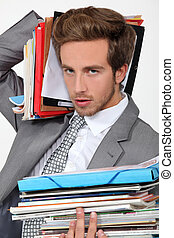 Man overwhelmed by files