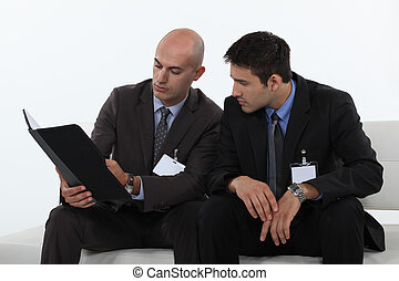 businessmen reading a report