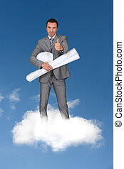 man wearing grey suit standing on cloud with rolled paper...
