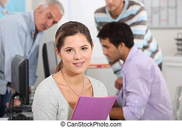 Woman surrounded by her colleagues at work