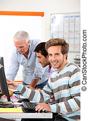 Smiling man in computing training