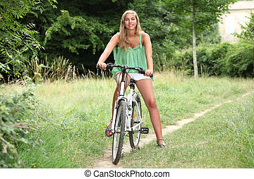 Blond teenage girl on bike ride