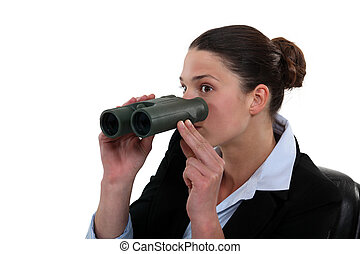 Office worker with a pair of binoculars