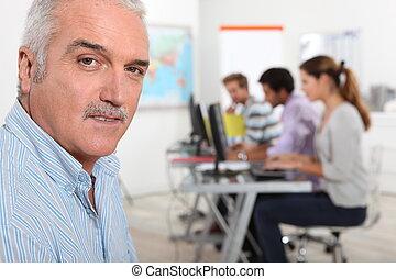 A teacher in his classroom