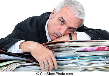 Man lying on paperwork