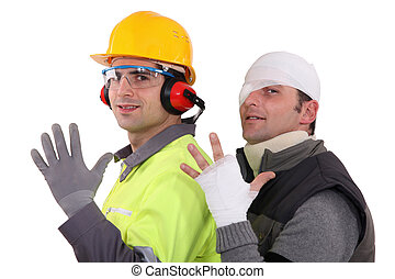 A construction worker and his injured colleague.