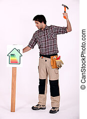 Man hammering post into ground